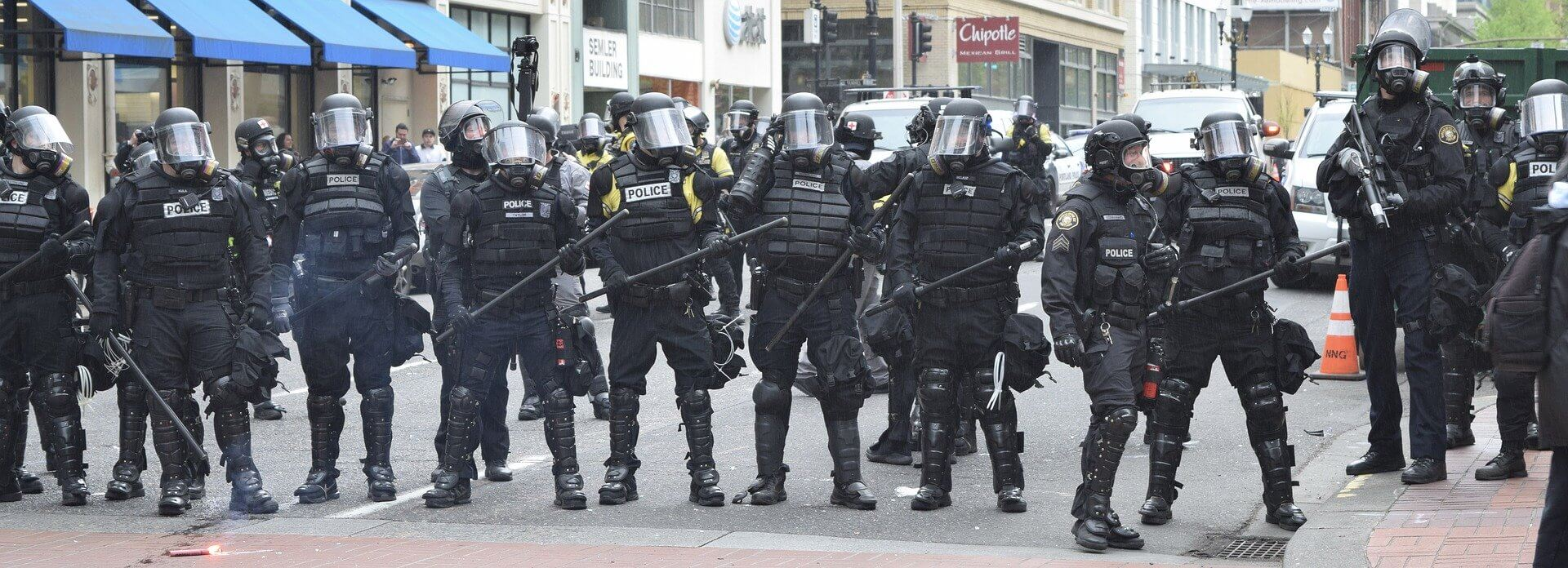 Police form ranks to break up protests in Portland, Or