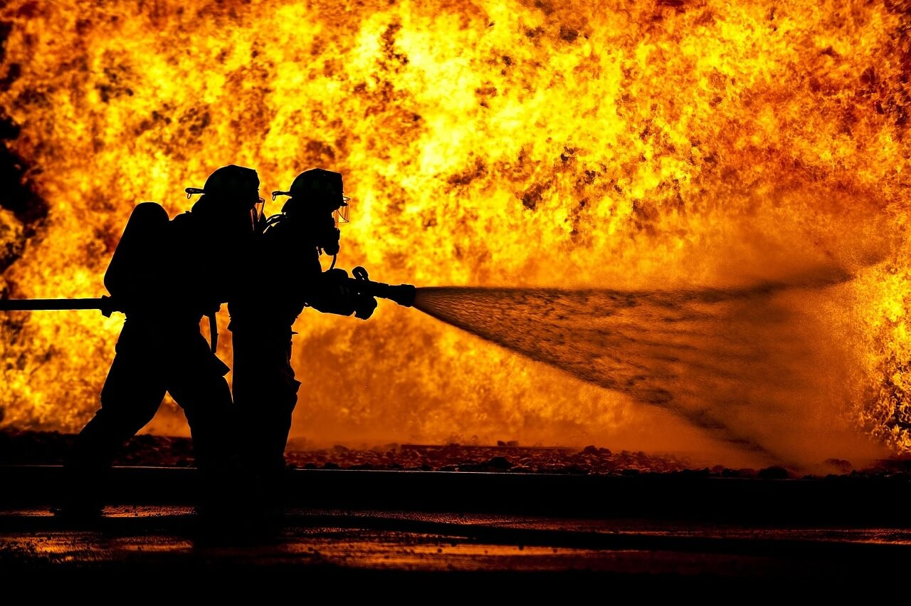 firefighters working to put out fires started during protests